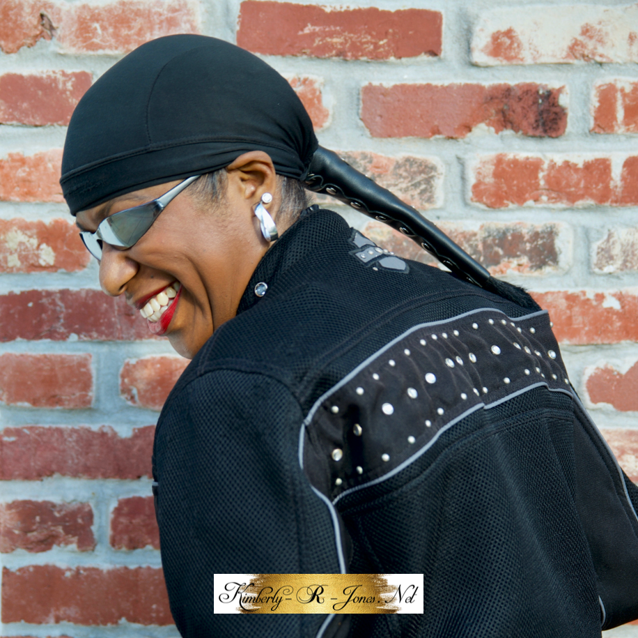 Kimberly R Jones wearing a motorcycle ponytail holder and skull cap