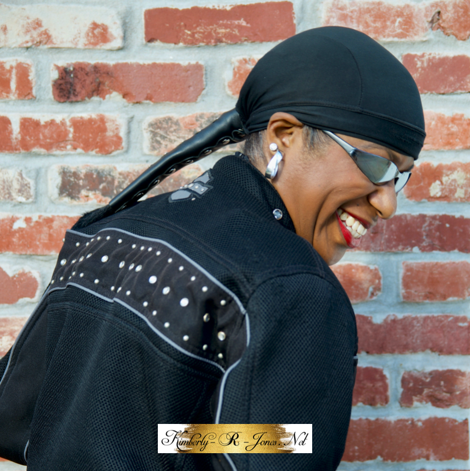 Kimberly R Jones wearing a black motorcycle ponytail holder and skull cap